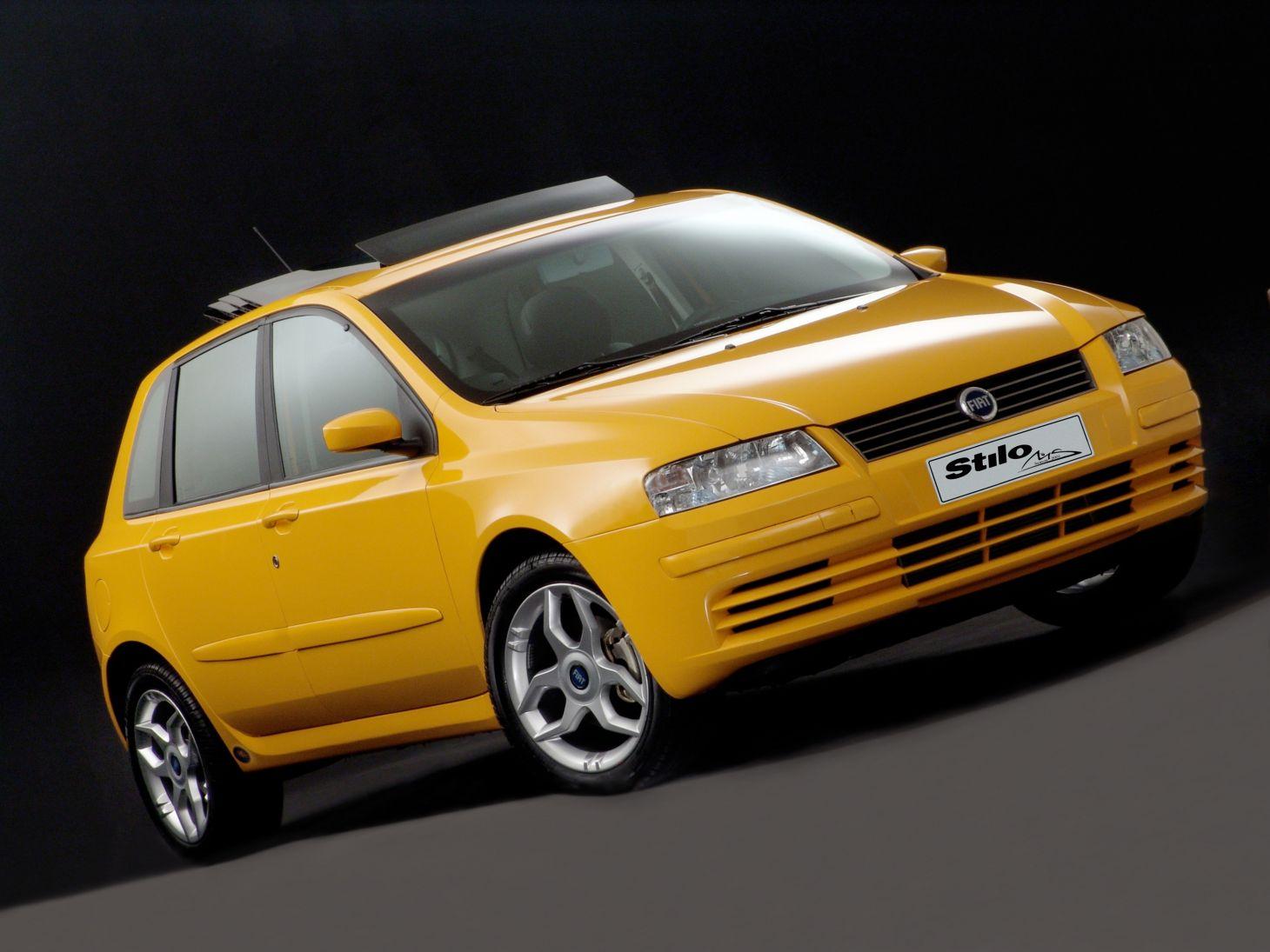 fiat stilo schumacher amarelo indianápolis de frente: três séries especiais desses carros homenagearem o piloto alemão, todas equipadas com teto solar sky window