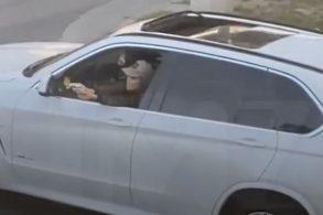 [Vídeo] Motorista de SUV BMW tem ataque de fúria dá tiros em plena rua