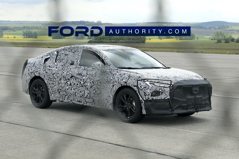 flagra novo ford fusion em testes camuflado de frente
