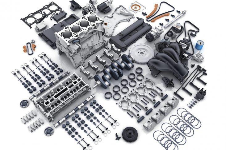 motor de carro desomntado com todos os componentes a mostra